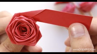 Repeat youtube video Cómo hacer rosas con una tira de papel (tipo quilling)