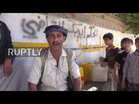 Yemen: Yemeni citizens collect water from public tap amidst cholera outbreak