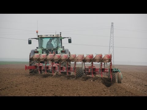 Big Tractor Ploughing with big plough in France