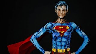 step inside the studio as a body artist transforms into superman
