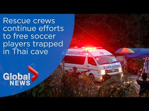 Thai rescue crews work to save boys trapped in flooded cave