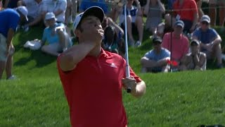 Jon Rahm reacts to an unbelievable lip out at Quicken Loans