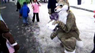 Lupercus fursuit entertaining kids at winter event