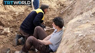 The War in Syria: Free Syrian Army fighters discover mass grave