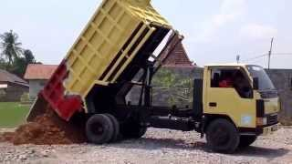 Dump Truck Mitsubishi unloading dirt