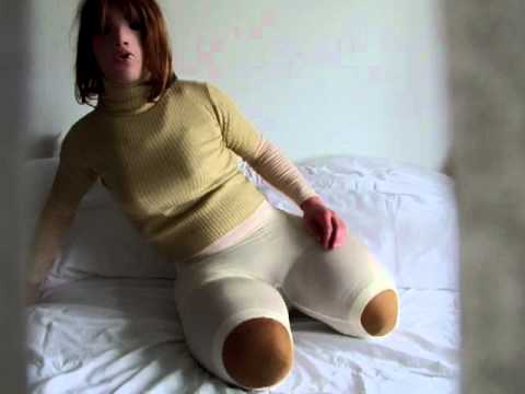 Quadruple amputee sitting on chair brunette shaved - 2 part 1