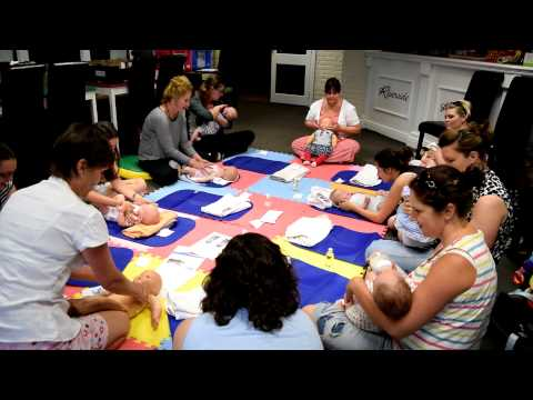 Health Visitor explaining baby massage and swimming