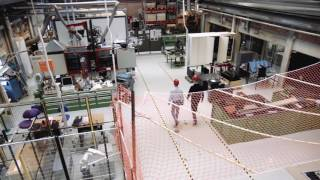 Fully autonomous drone flying in an indoor industrial environment.