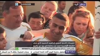 اللاجيء السوري إبراهيم الحسين يحمل الشعلة الأولمبية في أثينا في رحلتها إلى ريو دي جانيرو