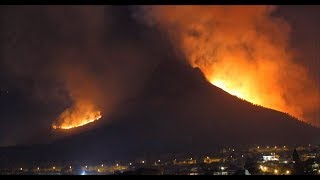 Huge grass fire blows to the foot of Cape Town's iconic Table Mountain