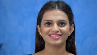 Portrait of a beautiful Indian woman smiling after a dental treatment