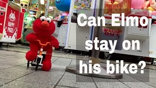 Can Elmo stay on his bike - Yes or No ?
