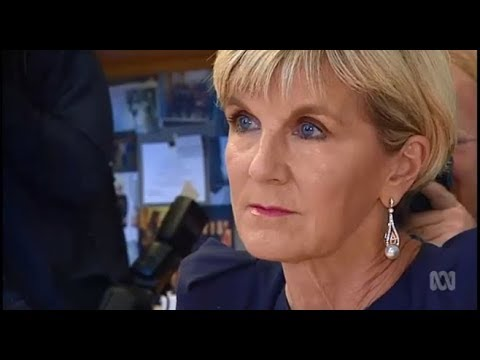 Julie Bishop gives Russian ambassador to Australia Grigory Logvinov the death stare