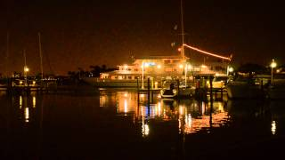 Yacht Starship pulling away from the dock at night, Clearwater Beach Marina