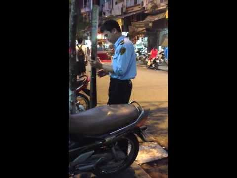 Banks Security ripping a bong while work, Hanoi Vietnam