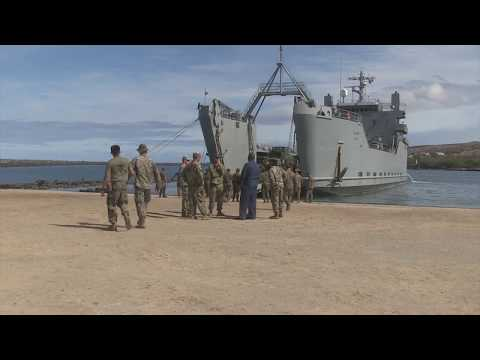 Logistics Marines unload vessel with heavy equipment on Hawaii