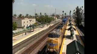 A mix of BNSF, Union Pacfic and Metrolink trains in  Riverside, CA