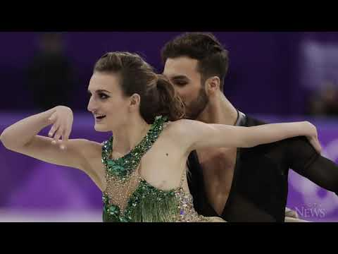 French figure skater powers through wardrobe malfunction