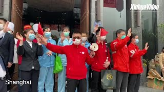 Chinese medical workers greeted with hero's welcome back home
