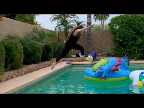Trying to Jump on Floats that are in the pool with all our cloths on