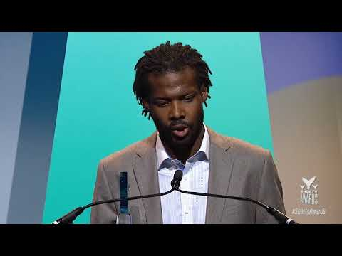 Reggie Harris accepts Best in Activism on behalf of Erica Garner