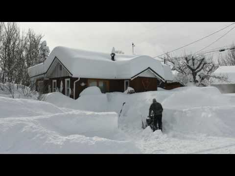 east glacier park, montana. digging out from blizzard