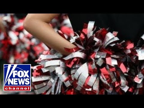 Inspiring: HS cheer squad joins lone cheerleader from opposing school
