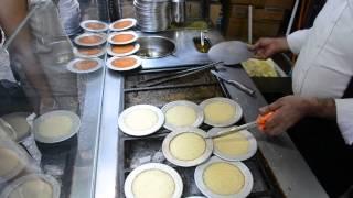 Making Kunefe (Turkish dessert) on the street in Istanbul