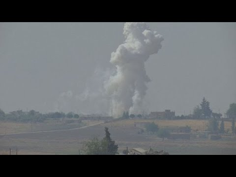 Explosions rock Syrian border towns as Turkey begins offensive