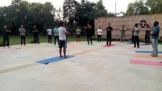NIB staff enjoying Laughter Yoga,