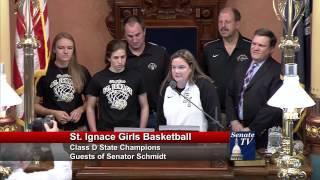 Senator Wayne Schmidt honors the St. Ignace Saints Class D Girls Basketball Team