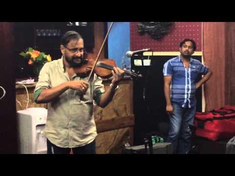 """""""Nee yen"""" music director Ousepachan playing Violin"""