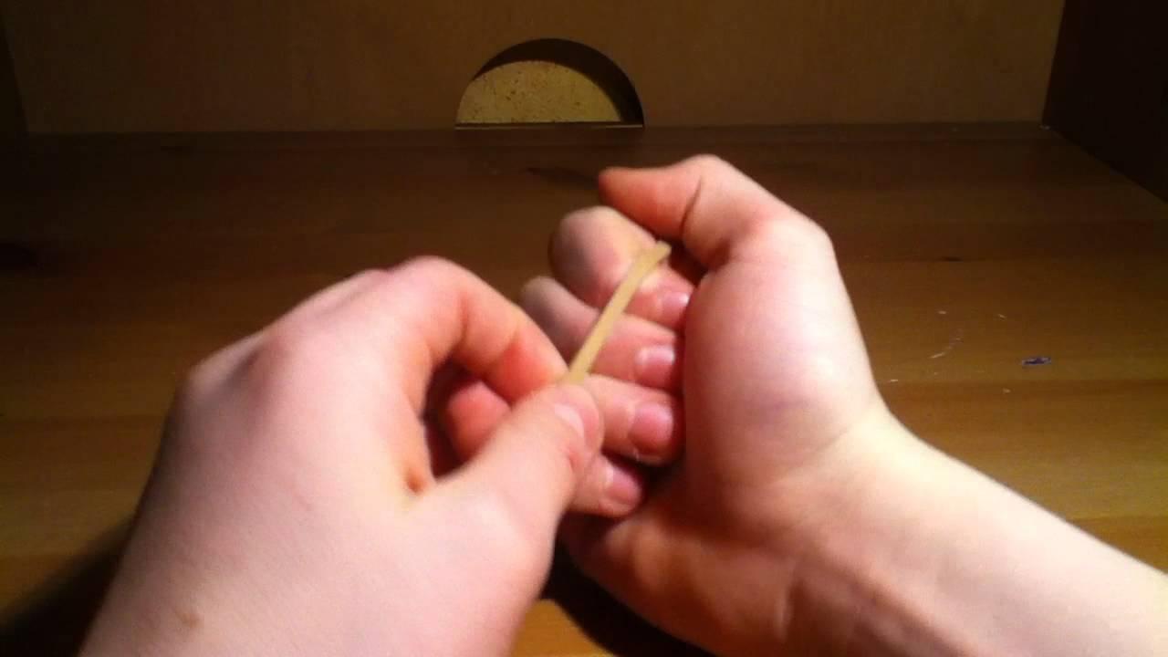 tour de magie elastique doigt