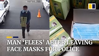 china-coronavirus-chinese-man-flees-after-leaving-face-masks-for-police-officers