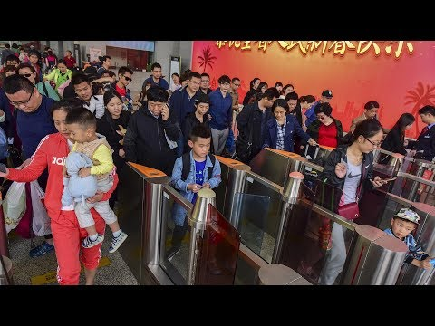 China's Spring Festival travel rush reflects 40 years of change in the country