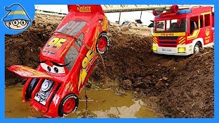 Lightning McQueen fell into a puddle of water. A fire truck tows a car.