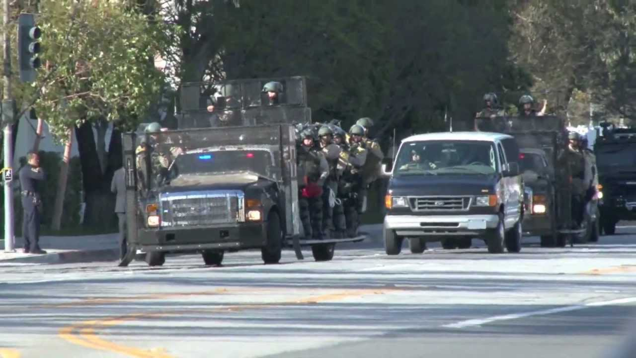 swat team takes over sony pictures obamas motorcade
