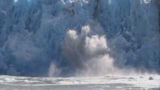 glacier calving tall wall of ice