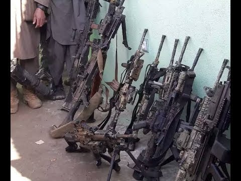 Taliban propaganda showcases U.S. weapons and radios as captured war spoils