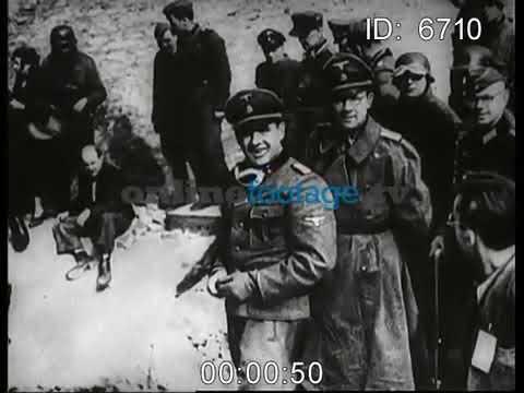 Warszawskie getto. Żydowska policja pomaga w wywózce Żydów do niemieckich obozów koncentracyjnych