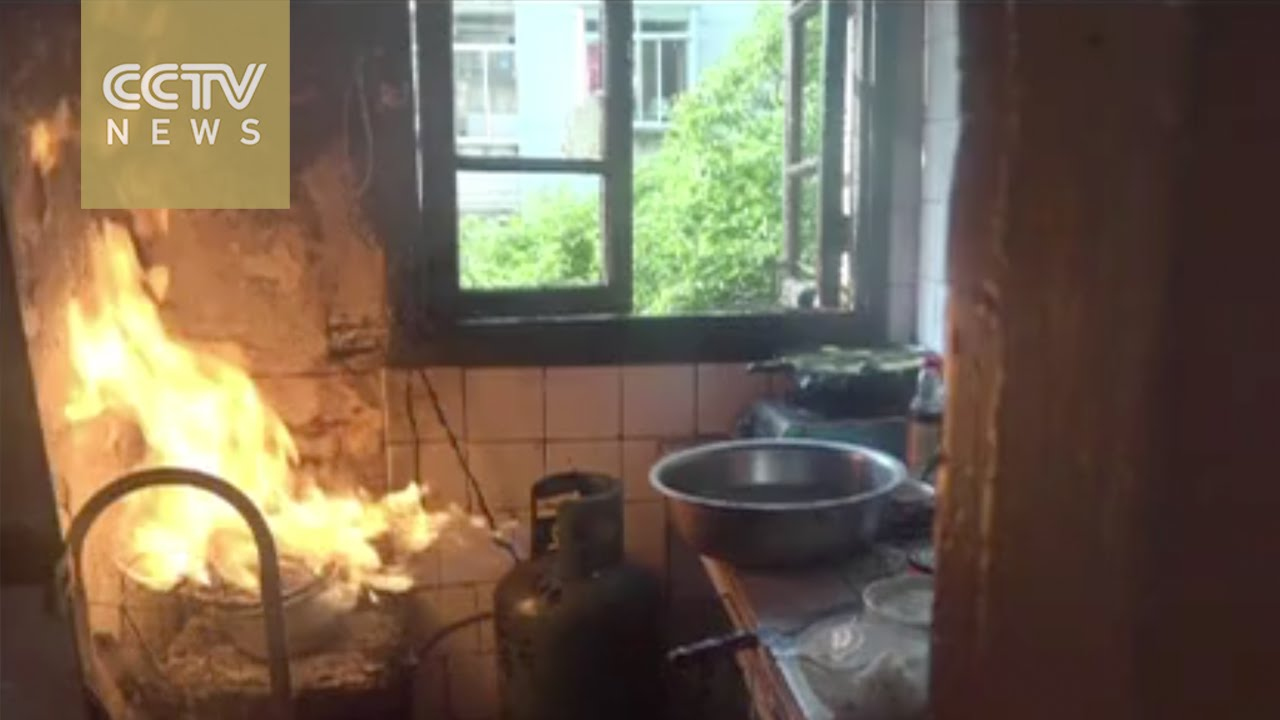 Hero fireman takes burning gas cylinder from blazing home