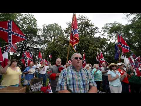 Confederate flag supporters sing I Wish I Was in Dixie