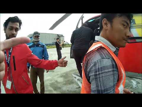 Helicopter transfer and landing in Lukla