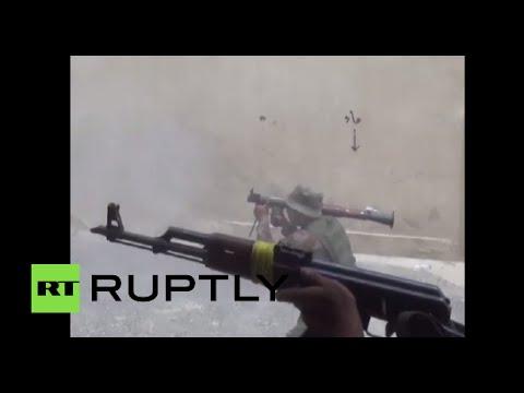 RAW: Shia militants battle ISIS for oil refinery town of Baiji