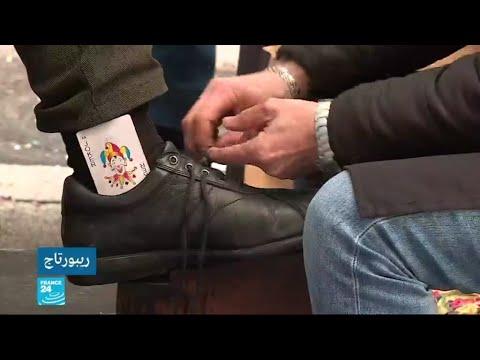 في صقلية.. شباب وشابات يمسحون الأحذية بسبب البطالة والفقر!!  - 16:54-2019 / 5 / 7