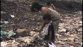 Smokey Mountain in Manila- sorting trash for metals & plastics to sell