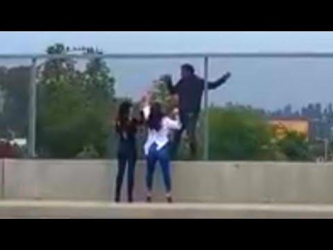 Women Talk Man Clinging to Overpass Out of Killing Himself