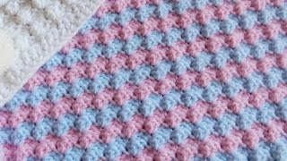 In this week's video tutorial I show you how to crochet the Half Shell Ripple Stitch or a Mixed Grit Stitch variation. I used this stitch in my recent two baby blankets and it creates a wonderful solid finish that is almost bobbly in effect. Very cosy with a good baby yarn.  C2C crochet tutorial: https://youtu.be/2-jjJa2osrw Pom Pom yarn shown is DY Choice Jester  Instagram: https://www.instagram.com/happyberrycrochet  Website: https://www.happyberry.co.uk Facebook: https://www.facebook.com/happyberrycrochet  Patreon: http://www.patreon.com/happyberry  This pattern is in US terminology, but details are given for UK terminology.   © HappyBerry This pattern can not be reproduced in any way without credit given to HappyBerry. This includes copying and pasting into another blog or website, and filming the pattern for use on YouTube. You can however print it off for personal use or for use in an offline crochet group. Items made from any of my patterns can be sold in your own stores however. Patterns are not for re-sale. Thank you.