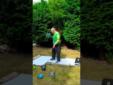 Ben exercising in the back Yard with Gareth Davies our friend and Personal Trainer.