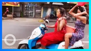 印尼網紅姐妹花邊洗頭邊騎車 被罰未戴安全帽
